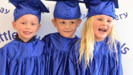 Little Owls from Toftwood and Scarning enjoy their graduation ceremony. (Left tor right) Jack Smith, Harrison Hook and...