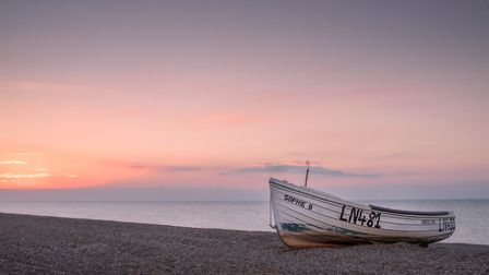 A little boat on the shingle at Cley-Next-The-Sea. Photo: JP Appleton