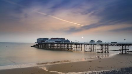 Waiting for dawn on the pier. Photo: Jeff Tebbutt