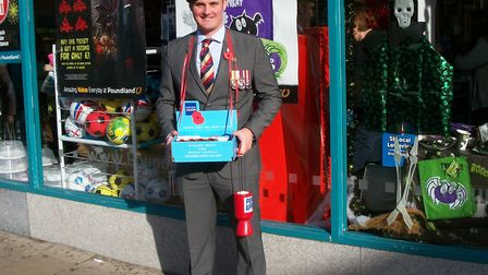 Liam Young collecting for the Royal British Legion in Dereham. Picture: Archant Library.