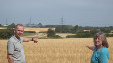 Jenny and Tony Smedley near the proposed site for the substations in Necton. Photo: Colin King