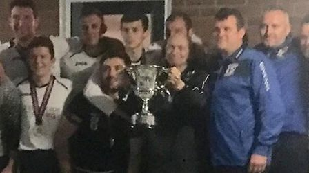 Steve Boddy, centre, lifting the Ben Smith Memorial Cup at the end of the 2017/2018 season with memb