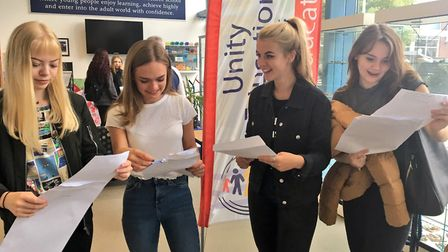 Students at Northgate High School opening their results. (L-R): Olivia Downes, 16, Thea Tooke, 16, Georgia Clements, 16...
