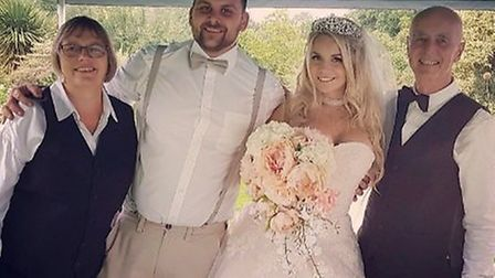 Tom Willmott and his wife Kayleigh on their wedding day, organised within three weeks. Pictured is M