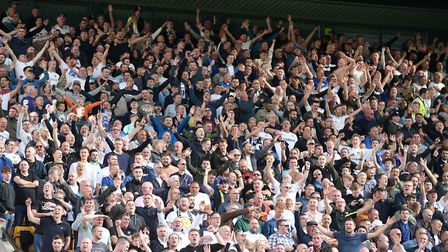 The traveling Leeds fans celebrate their side's 3rd goal during the Sky Bet Championship match at Ca