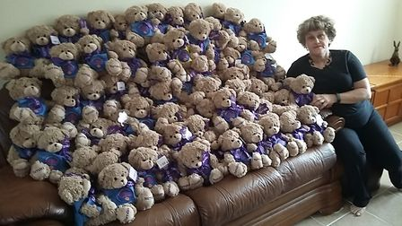 Janet Spauls, with the PC Teds members of the Dereham Lions have been making uniforms for. Picture: