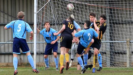 Fakenham's James Tricks taking a kick to the head, while trying to head for goal from a corner kick.