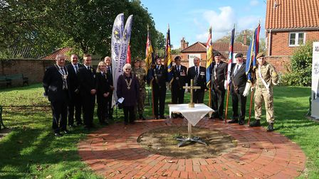 Royal British legion standard bearers and others gathered for the Torch of Remembrance ceremony at D