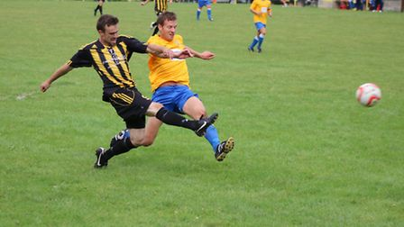 Ben Boyce rifles home Fakenham Town's equaliser which earned an FA Cup replay against Newmarket Town
