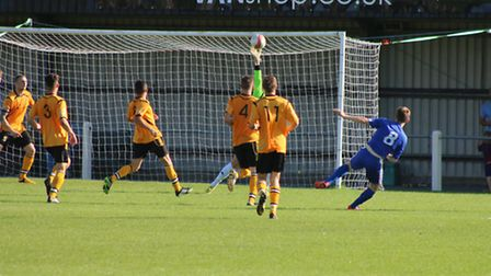 Tommy Rix makes a fine save to keep the score down. Picture: TONY MILES