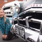 Eight-year-old Poppy Jones admires a 1952 Plymouth on show at the Reepham Classic Car Festival. Pict