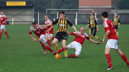 Luke Gray in action for Fakenham Town Reserves on Saturday. Picture: TONY MILES