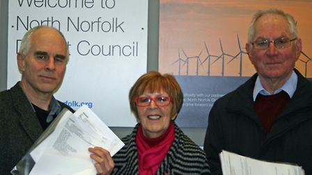 Campaigners Richard Crook, Janet Holdon and Ian Ponton with copies of the questionnaires supporting