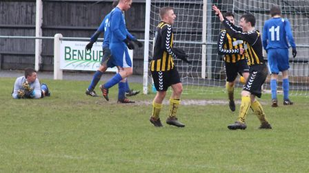 Connor Walker, left, takes the plaudits after finding the net during Fakenham Town Reserves' 8-1 wee