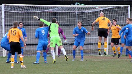 Fakenham keeper Tommy Rix makes a nuisance of himself in the opposing box. Picture: TONY MILES