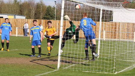Somehow Ipswich's keeper managed to claw this Dion Frary shot out of the goal. Picture: TONY MILES