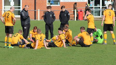 Neil Jarvis, standing, second from left, lays down the law after Fakenham's loss on Saturday. Pictur