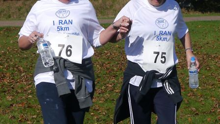 Two members of staff take part in last year's run.