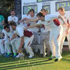 The alcohol flows as Fakenham celebrate winning the title. Picture: RONNIE HEYHOE