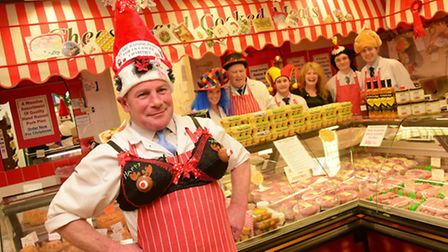 Butcher Carl Anderton wears a fancy bra and the staff of Papworth's Butchers in Fakenham wear silly