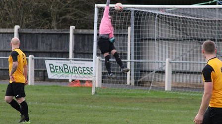 Sam Garner lobs the Long Melford keeper to score in Fakenham Town's weekend win. Picture: TONY MILES