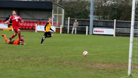 Ashley Jarvis puts Fakenham Town in front on Saturday. Picture: TONY MILES