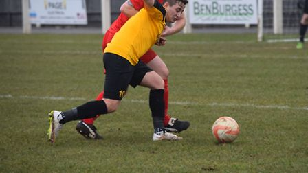 Fakenham Town's Ricky Claxton tries to hold off an opponent on Saturday. Picture: JACKIE PRICE