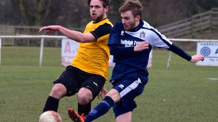 Danny Williams, left, in action for Fakenham Town on Saturday. Picture: JACKIE PRICE