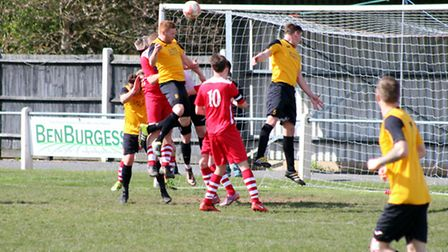 Kyle Plumb climbs highest to head Fakenham Town in front on Saturday. Picture: TONY MILES