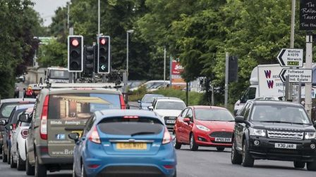 A typical scene of busy traffic on Tavern Lane, Dereham. The town's council says building a new 10,0