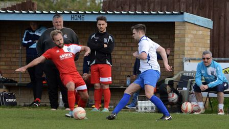 Action from Fakenham Town's narrow defeat at Godmanchester on East Monday. Picture: Archant