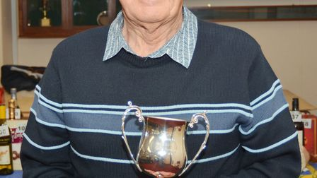 Johnny Wright with Fakenham Gallows Indoor Bowls Club's Negus Personality Award. Picture: Peter Bird