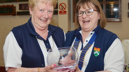 New Fakenham Gallows Bowls Club's ladies' president Marie Frost (right) presents the Vera Wright Ros