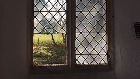 A window was smashed at St Mary's Church in Beeston-next-Mileham. Pictures: supplied by Caroline Raw