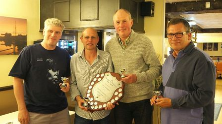 League winners Little Snoring A with the Dereham & Fakenham Times Shield, from left to right, Garry