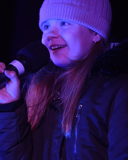 Savannah Clinton sings a song she wrote for her brother Denver at the Dereham Christmas lights switc