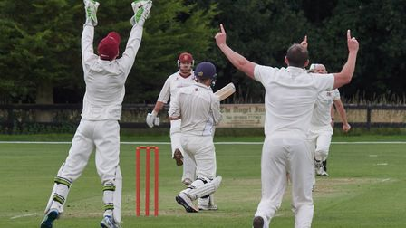 Cooke's of Fakenham man of the match Tom Yarham takes another catch behind the stumps off Steve Earl