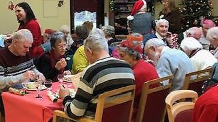 Dereham Meeting Point regulars enjoying a Christmas party at the St Withburga Lane centre.Photo: SUP