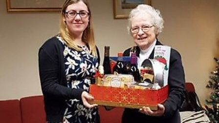 Justina Weeks being presented with first prize by Dereham mayor Hilary Bushell. Picture: WARD GETHIN