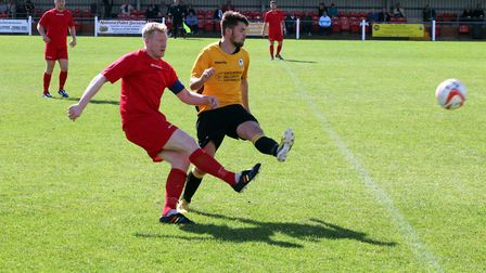 Fakenham's Tim Cary in the thick of the action at Clipbush Park at the weekend. Picture: Tony Miles