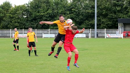 Fakenham Town's Lewis Sturman, who later dislocated his shoulder, goes up for a high ball during Sat