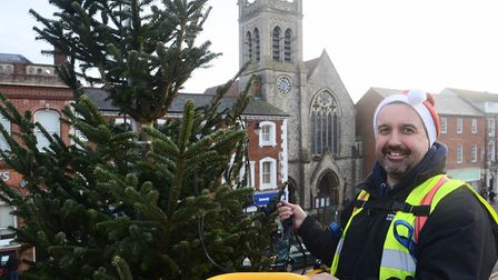Roger Atterwill putting the lights on the Christmas tree in Dereham town centre. Picture: Ian Burt