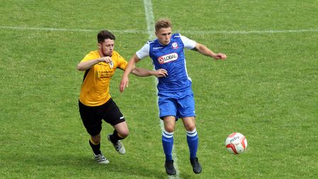 Fakenham Town's Tim Cary keeps close tabs on a Coggeshall opponent. Picture: Tony Miles