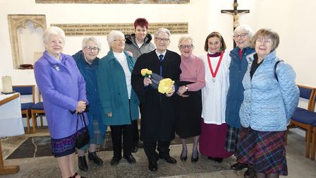 David Webster', in centre, with his team of church cleaners, affectionately called 'The Holy Dusters
