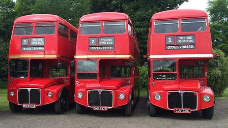The couple now own three double decker red London buses. Photo: BUS AND US