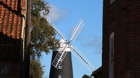 Burnham Overy Windmill seen through the gap in the cottages. Picture: Martin Sizeland