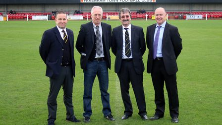 Posing for a picture at the start of a new era for Fakenham Town are, from left to right, Doug Colma