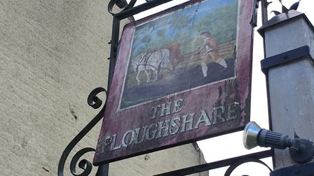 The sign at the Ploughshare pub in Beeston, which is being refurbished by village volunteers. Pictur