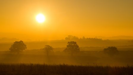 Morning mist and sun over North Creake. Picture: Tom Mowat