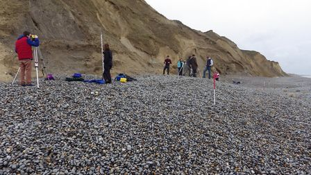 A-level geography students from Fakenham sixth form measuring changes to the elevation of the beach